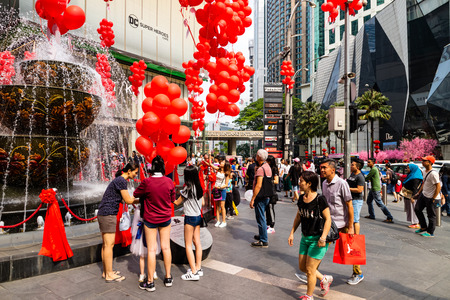 KUALA LUMPUR, MALAYSIA - FEBRUARY 10, 2018 : Crowd of people walk in front of water fountain with beautiful chinese new year decorations at Pavilion shopping center in Bukit Bintang district, Kuala Lumpur. Editorial