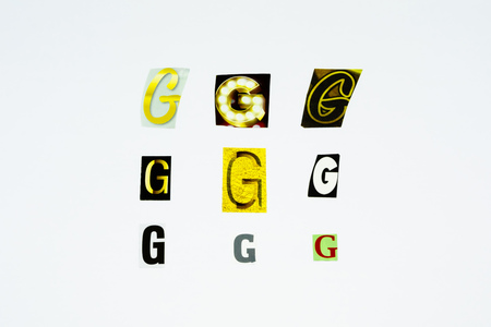 Set of collection colorful newspaper cut out letters as ornaments or design elements. Isolated on white background. Letter G.