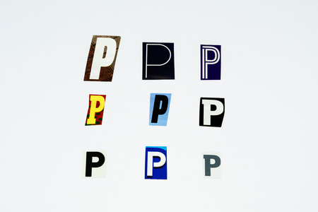 Set of collection colorful newspaper cut out letters as ornaments or design elements. Isolated on white background. Letter P.