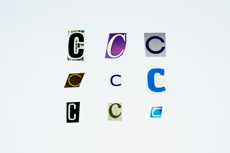 Set of collection colorful newspaper cut out letters as ornaments or design elements. Isolated on white background. Letter C. Stock Photo