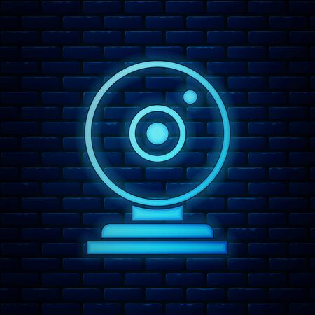 Glowing neon Web camera icon isolated on brick wall background. Chat camera. Webcam icon. Vector Illustration Vector Illustration
