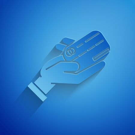 Paper cut Human hand holding with credit card icon isolated on blue background. Online payment. Pay by card. Financial operations. Paper art style. Vector Illustration