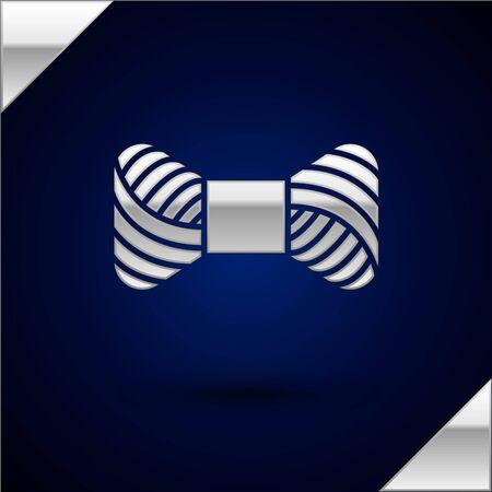 Silver Sewing thread on spool icon isolated on dark blue background. Yarn spool. Thread bobbin. Vector Illustration