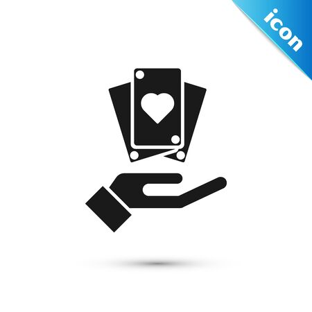 Black Hand holding playing cards icon isolated on white background. Casino game design. Vector Illustration