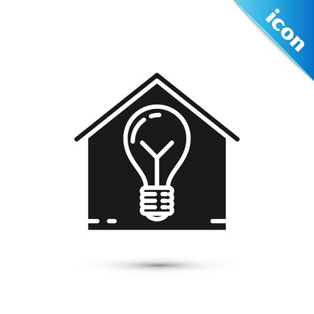 Black Smart house and light bulb icon isolated on white background. Vector Illustration