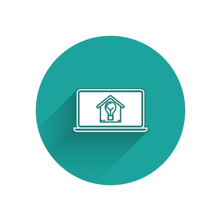 White Laptop with smart house and light bulb icon isolated with long shadow. Green circle button. Vector Illustration