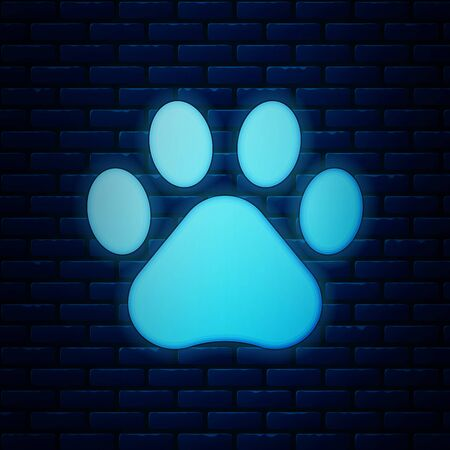 Glowing neon Paw print icon isolated on brick wall background. Dog or cat paw print. Animal track. Vector Illustration