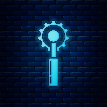 Glowing neon Cutter tool icon isolated on brick wall background. Sewing knife with blade. Vector Illustration
