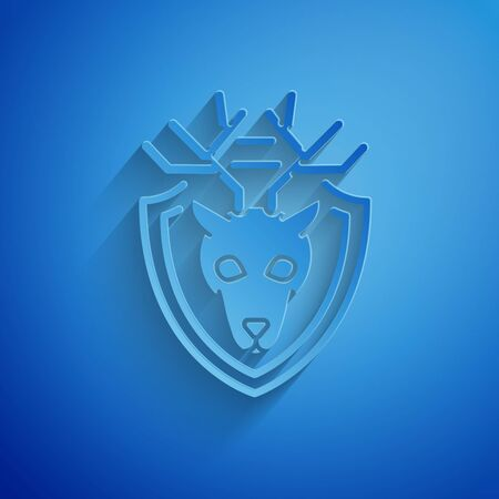 Paper cut Deer head with antlers on shield icon isolated on blue background. Hunting trophy on wall. Paper art style. Vector Illustration