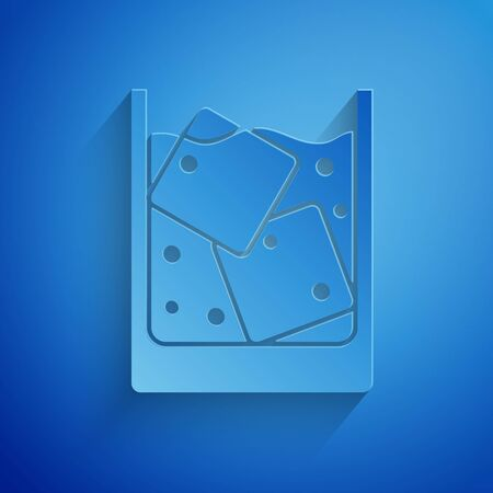 Paper cut Glass of whiskey and ice cubes icon isolated on blue background. Paper art style. Vector Illustration