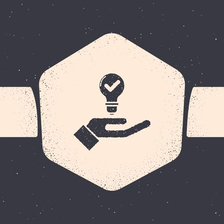 Grunge Light bulb in hand icon isolated on grey background. Concept of idea. Monochrome vintage drawing. Vector Illustration