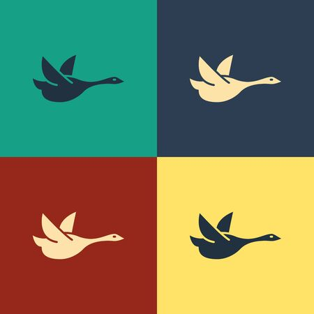 Color Flying duck icon isolated on color background. Vintage style drawing. Vector Illustration