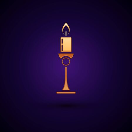 Gold Burning candle in candlestick icon isolated on dark blue background. Old fashioned lit candle. Cylindrical candle stick with burning flame. Vector Illustration