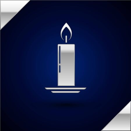 Silver Burning candle in candlestick icon isolated on dark blue background. Old fashioned lit candle. Cylindrical candle stick with burning flame. Vector Illustration