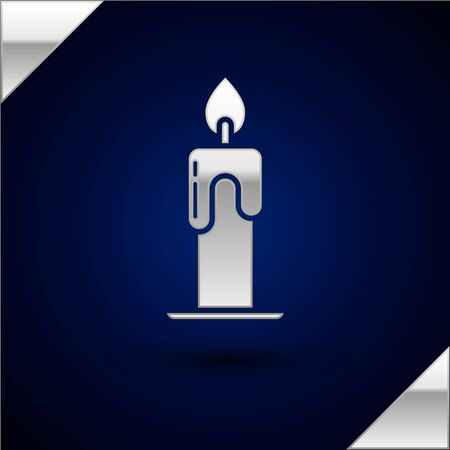 Silver Burning candle icon isolated on dark blue background. Cylindrical aromatic candle stick with burning flame. Happy Halloween party. Vector Illustration