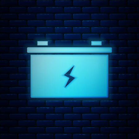 Glowing neon Car battery icon isolated on brick wall background. Accumulator battery energy power and electricity accumulator battery. Vector Illustration