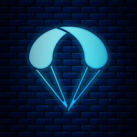 Glowing neon Parachute icon isolated on brick wall background. Extreme sport. Sport equipment. Vector Illustration