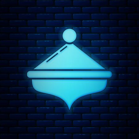 Glowing neon Hanukkah dreidel icon isolated on brick wall background. Vector Illustration