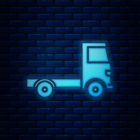 Glowing neon Delivery cargo truck vehicle icon isolated on brick wall background. Vector Illustration