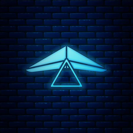 Glowing neon Hang glider icon isolated on brick wall background. Extreme sport. Vector Illustration