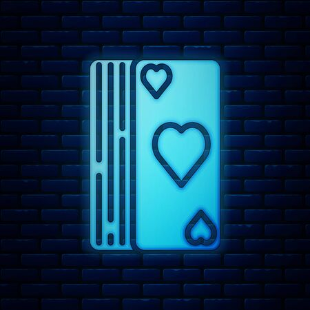Glowing neon Deck of playing cards icon isolated on brick wall background. Casino gambling. Vector Illustration