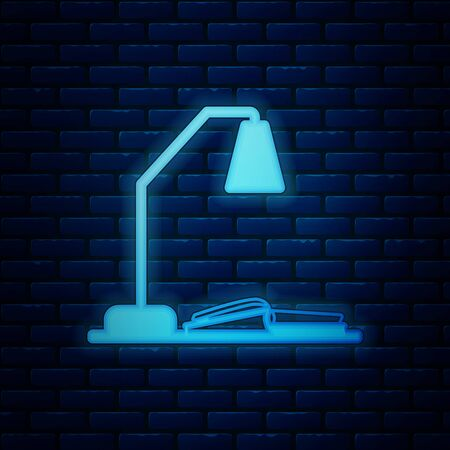 Glowing neon Workplace with table lamp and open book icon isolated on brick wall background. Table office lamp. Vector Illustration Иллюстрация