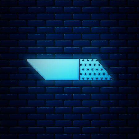 Glowing neon Eraser or rubber icon isolated on brick wall background. Vector Illustration