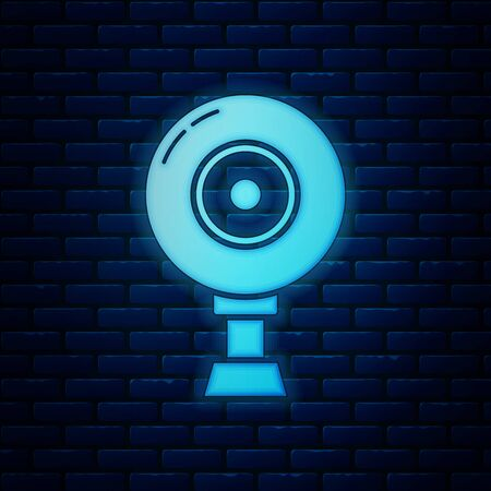Glowing neon Web camera icon isolated on brick wall background. Chat camera. Webcam icon. Vector Illustration Иллюстрация