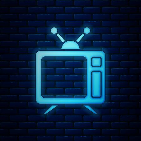 Glowing neon Tv icon isolated on brick wall background. Television sign. Vector Illustration  イラスト・ベクター素材