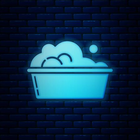 Glowing neon Plastic basin with soap suds icon isolated on brick wall background. Bowl with water. Washing clothes, cleaning equipment. Vector Illustration Illustration