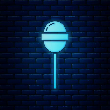 Glowing neon Lollipop icon isolated on brick wall background. Food, delicious symbol. Vector Illustration