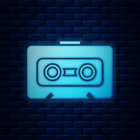 Glowing neon Retro audio cassette tape icon isolated on brick wall background. Vector Illustration