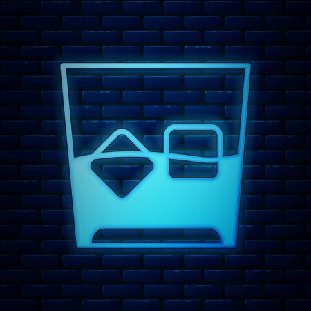 Glowing neon Glass of whiskey and ice cubes icon isolated on brick wall background. Vector Illustration Banco de Imagens - 130819009