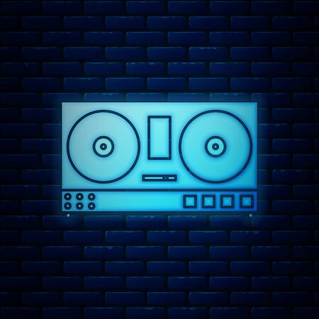 Glowing neon DJ remote for playing and mixing music icon isolated on brick wall background. DJ mixer complete with vinyl player and remote control. Vector Illustration