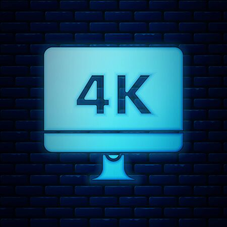 Glowing neon Computer PC monitor display with 4k video technology icon isolated on brick wall background. Vector Illustration