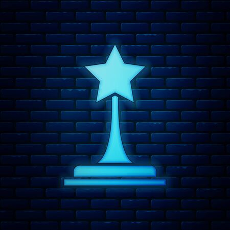 Glowing neon Movie trophy icon isolated on brick wall background. Academy award icon. Films and cinema symbol. Vector Illustration