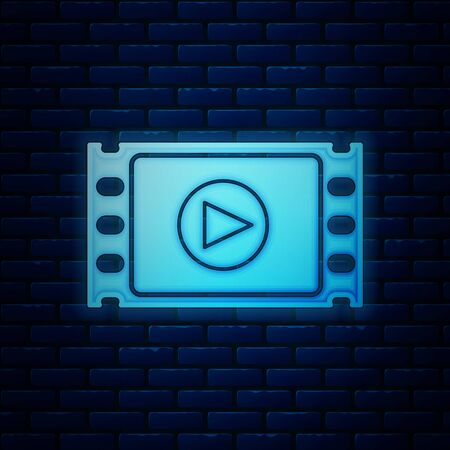 Glowing neon Play Video icon isolated on brick wall background. Film strip with play sign. Vector Illustration