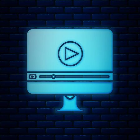 Glowing neon Online play video icon isolated on brick wall background. Computer monitor and film strip with play sign. Vector Illustration