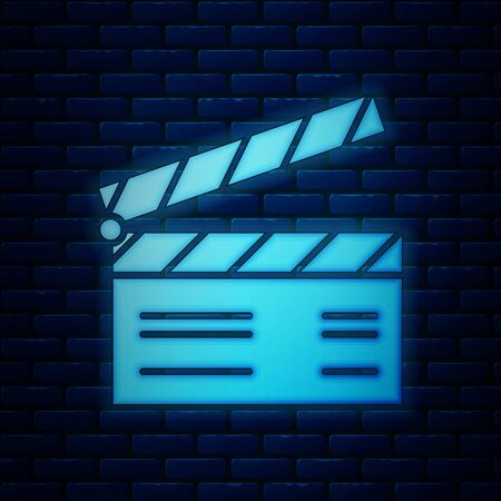 Glowing neon Movie clapper icon isolated on brick wall background. Film clapper board. Clapperboard sign. Cinema production or media industry concept. Vector Illustration