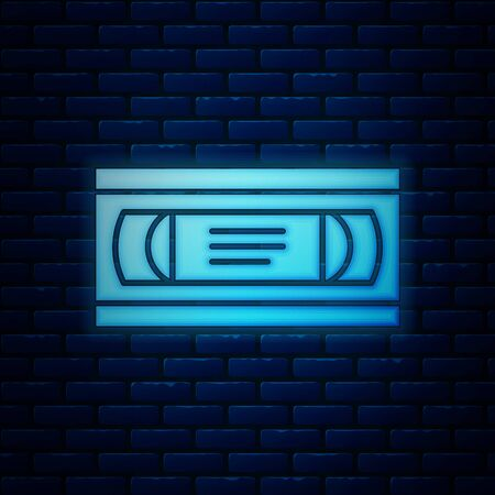 Glowing neon VHS video cassette tape icon isolated on brick wall background. Vector Illustration
