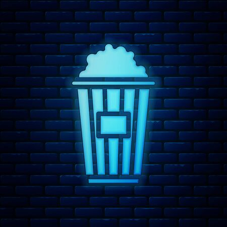 Glowing neon Popcorn in cardboard box icon isolated on brick wall background. Popcorn bucket box. Vector Illustration