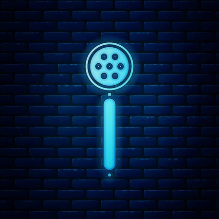 Glowing neon Strainer spoon icon isolated on brick wall background. Vector Illustration