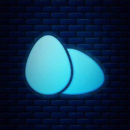 Glowing neon Chicken egg icon isolated on brick wall background. Vector Illustration