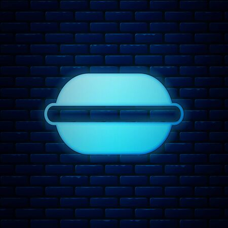 Glowing neon Macaron cookie icon isolated on brick wall background. Macaroon sweet bakery. Vector Illustration