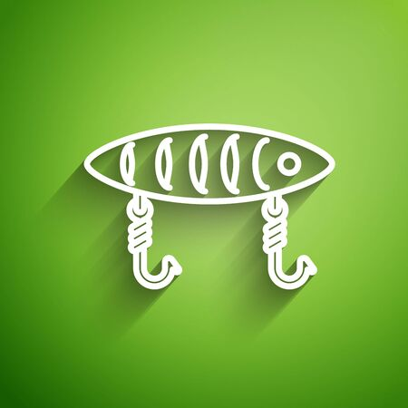 White line Fishing lure icon isolated on green background. Fishing tackle. Vector Illustration