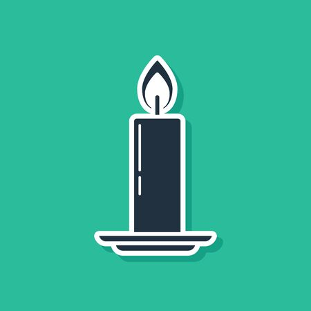 Blue Burning candle in candlestick icon isolated on green background. Old fashioned lit candle. Cylindrical candle stick with burning flame. Vector Illustration Ilustracja