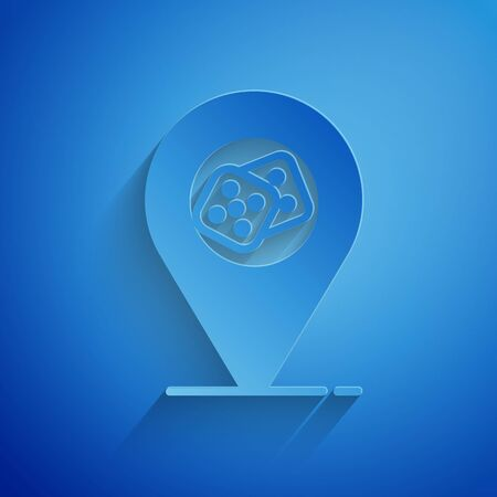 Paper cut Casino location icon isolated on blue background. Game dice icon. Paper art style. Vector Illustration