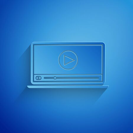 Paper cut Online play video icon isolated on blue background. Laptop and film strip with play sign. Paper art style. Vector Illustration Ilustração