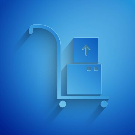 Paper cut Hand truck and boxes icon isolated on blue background. Dolly symbol. Paper art style. Vector Illustration