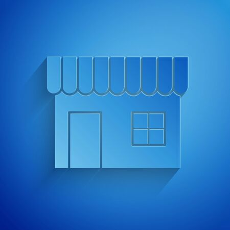 Paper cut Shopping building or market store icon isolated on blue background. Shop construction. Paper art style. Vector Illustration